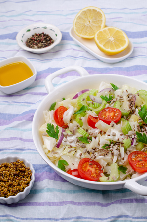 Salad of raw vegetables with seeds in a bowl on a crumpled textile background. Selective focus. Standard-Bild - 121034507