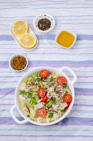 Salad of raw vegetables with seeds in a bowl on a crumpled textile background. Selective focus. Standard-Bild - 121034511