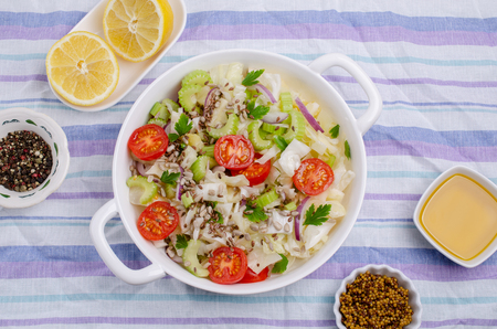 Salad of raw vegetables with seeds in a bowl on a crumpled textile background. Selective focus. Standard-Bild - 121034519
