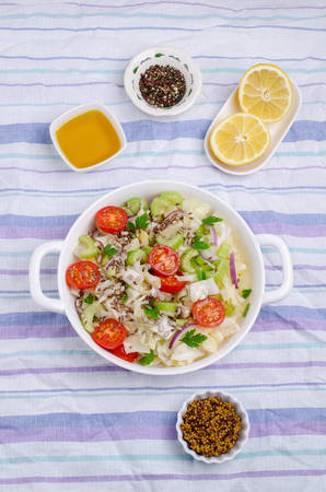 Salad of raw vegetables with seeds in a bowl on a crumpled textile background. Selective focus. Standard-Bild - 121034520