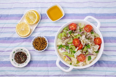 Salad of raw vegetables with seeds in a bowl on a crumpled textile background. Selective focus. Standard-Bild - 121034521