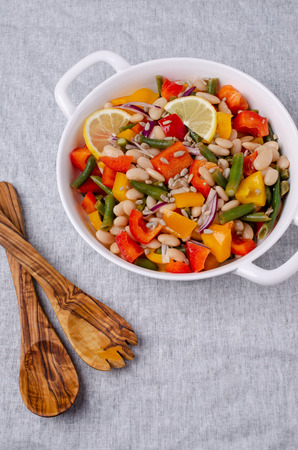 Vegetable salad with beans and sunflower seeds in a bowl on the table. Selective focus. Standard-Bild - 121034627
