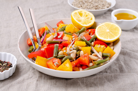 Vegetable salad with beans and sunflower seeds in a bowl on the table. Selective focus. Standard-Bild - 121034632