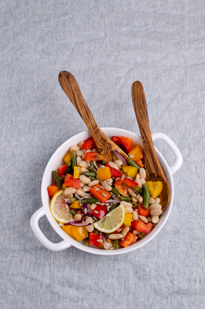 Vegetable salad with beans and sunflower seeds in a bowl on the table. Selective focus. Standard-Bild - 121034641