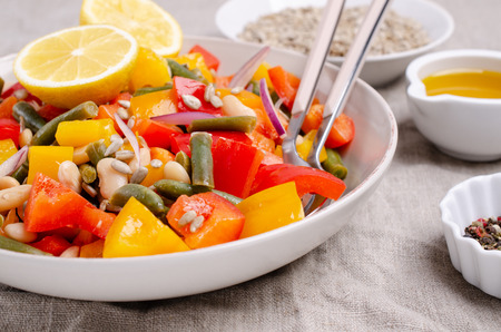 Vegetable salad with beans and sunflower seeds in a bowl on the table. Selective focus. Standard-Bild - 121034642