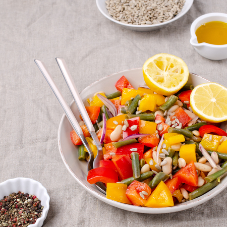 Vegetable salad with beans and sunflower seeds in a bowl on the table. Selective focus. Standard-Bild - 121034643
