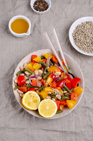Vegetable salad with beans and sunflower seeds in a bowl on the table. Selective focus. Standard-Bild - 121034645