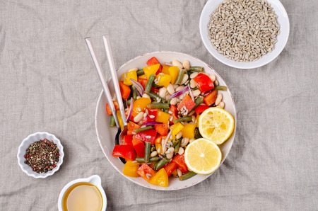 Vegetable salad with beans and sunflower seeds in a bowl on the table. Selective focus. Standard-Bild - 121034646