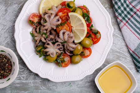 Salad with octopus and fresh vegetables in the marinade. Selective focus. Stock Photo