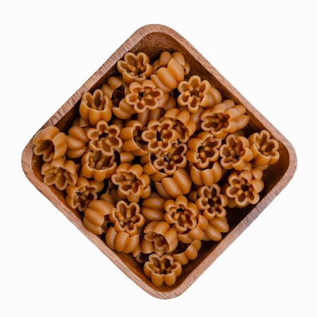 Dry pasta in a bowl on a white background. The concept of healthy eating.