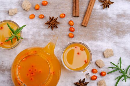 Vitamin healthy sea buckthorn tea in glass with spices on a wooden background. Selective focus. 写真素材 - 129419785