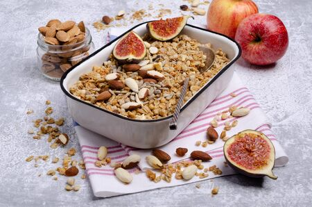 Granola with fruit, nuts and seeds on a slate background. Selective focus.