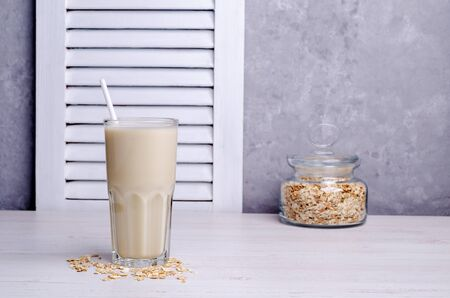 Alternative milk with the oats in the glass. The concept of healthy eating. Selective focus.