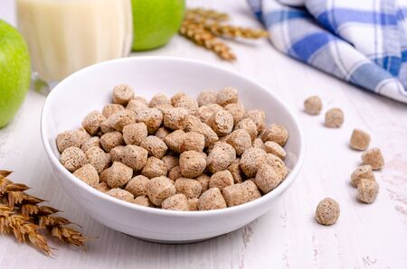 Pressed cereal bran in a bowl on a wooden background. The concept of healthy eating. Selective focus.