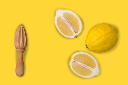 Fresh yellow lemons on an old blue background. Design concept. Selective focus.