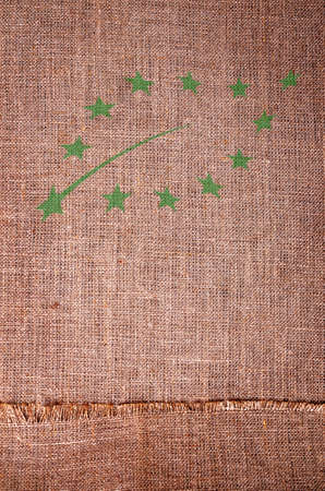 Symbol stamped on goods sackcloth. Design concept. Copy of the space.
