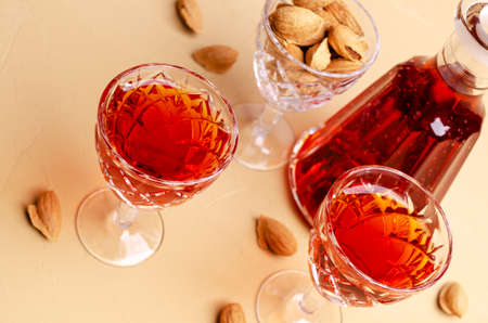 Traditional brown almond liquid in a glass on a stone background. Selective focus.