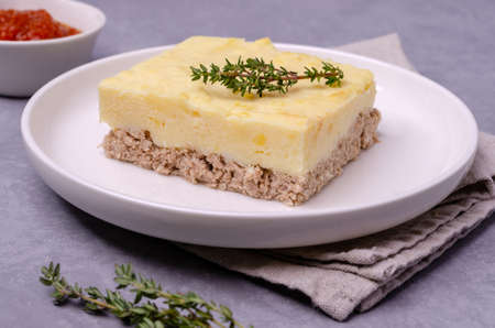 Potato casserole with minced meat in a dish on a stone background. Selective focus. Archivio Fotografico