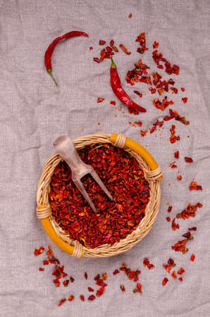 Slices of dry red pepper. A copy of the space. The concept of the design. Reklamní fotografie