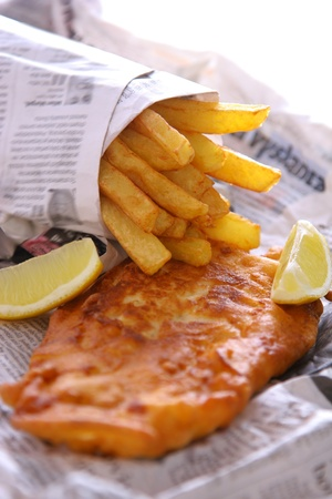 eating fish: Fish and chips to go Stock Photo