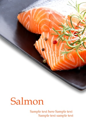 Nice pieces of raw salmon on white background