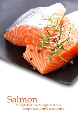 Nice pieces of raw salmon on white background photo