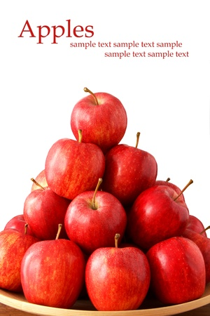 Bowl of red apples on white background with place for text photo