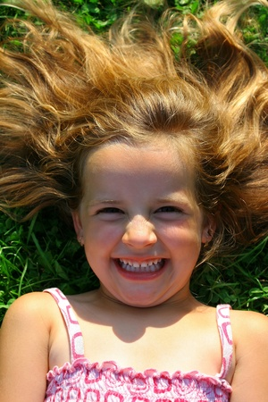 Cute little girl happy during summer photo