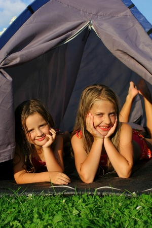 Two sisters camping Stock Photo - 12457281