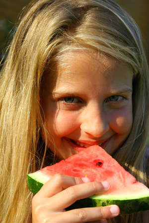 Little girl eating water melon photo