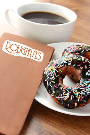Fresh doughnut with chocolate topping, coffee and menu photo