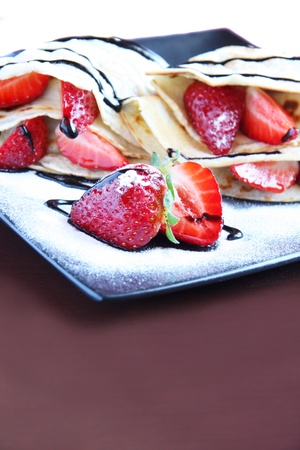 Pancakes with strawberry and chocolate topping photo