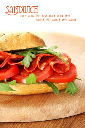 Fresh sandwich with chorizo and tomatoes photo