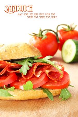 Fresh sandwich with chorizo and tomatoes photo