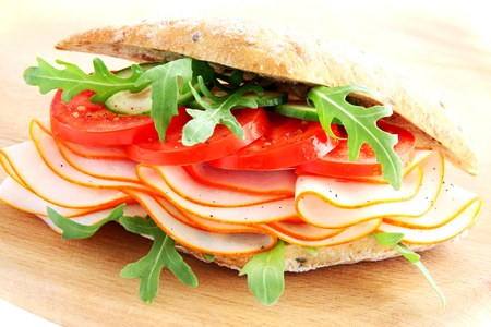 Fresh sandwich with ham and tomatoes photo