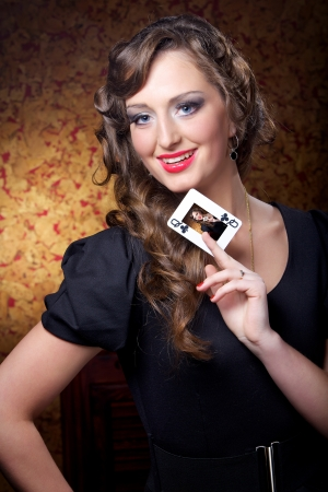 The charming woman with a card  photo