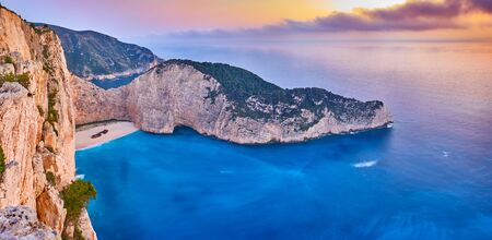 Navagio Beach with shipwreck view on Zakynthos island, Greece. Incredibly romantic sunrise on Zakinthos. Amazing sunset view with multicolored clouds. Island of lovers. Doors to heaven Stock Photo