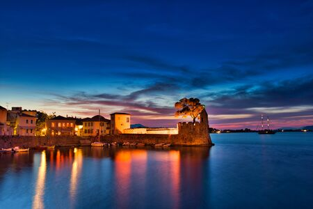 Panoramic view of the illuminated port of Nafpaktos, Greece. Nafpaktos is a popular tourist destination and a picturesque coastal town, former municipality in Aetolia-Acarnania, West Greece