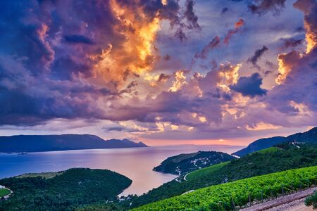 Kremena village location, Croatia, Europe. Dramatic evening seascape of Adriatic sea. Wonderful seascape with Rizman vineyard on foreground. Beautiful world of Mediterranean countries.