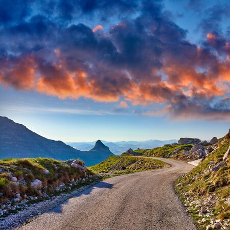 Amaizing sunset view on Durmitor mountains, National Park, Mediterranean, Montenegro, Balkans, Europe.  Bright summer view from Sedlo pass.Way through the mountain. Colored clouds.