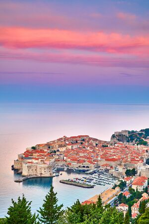 Aerial view at famous european travel destination in Croatia, Dubrovnik old town, Dalmatia, Europe. U. Fort Bokar seen from south old walls on a sunny day in dramatic light.