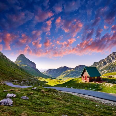Amaizing sunset view on Durmitor mountains, National Park, Mediterranean, Montenegro, Balkans, Europe.  Bright summer view from Sedlo pass. picture. Way through the mountain. Colored clouds.