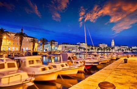 Split, Croatia. View of Split - the second largest city of Croatia at night. Shore of the Adriatic Sea and famous Palace of the Emperor Diocletian. Traveling concept background. Mediterranean countries. Stock Photo