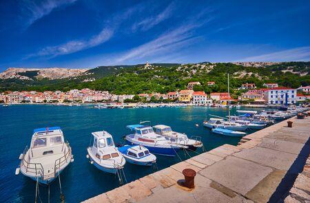 Panoramic view of Baska town. Bright summer seascape of Adriatic sea, Krk island, Kvarner bay archipelago, Croatia, Europe. Splendid morning cityscape of Bashka town.  Beautiful world of Mediterranean countries.