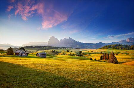 Wonderful summer view of Dolomiti Alps. Attractive morning scene of Compaccio village, Seiser Alm or Alpe di Siusi location, Bolzano province, South Tyrol, Italy, Europe. Dolomiti hills