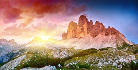 Amazing view of The Three Peaks of Lavaredo (Tre Cime di Lavaredo) at sunrise. Trentino Alto Adidge, Dolomites mountains, South Tyrol, Italy, Europe.