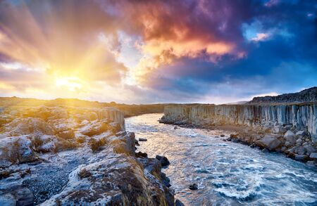 Colorful clouds over Selfoss waterfall. Iceland, Jokulsa National Park, Fjollum river, Europe. . Popular tourist attraction. Travelling concept background. Golden Ring Of Iceland. Beautiful Postcard.