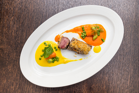 Steak of lamb with vegetable puree in the style yin yang Stock Photo