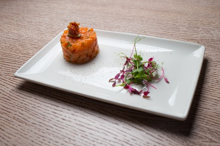 chopped raw salmon slices with spices