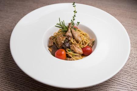 Exclusive recipe of spaghetti with quail meat Фото со стока